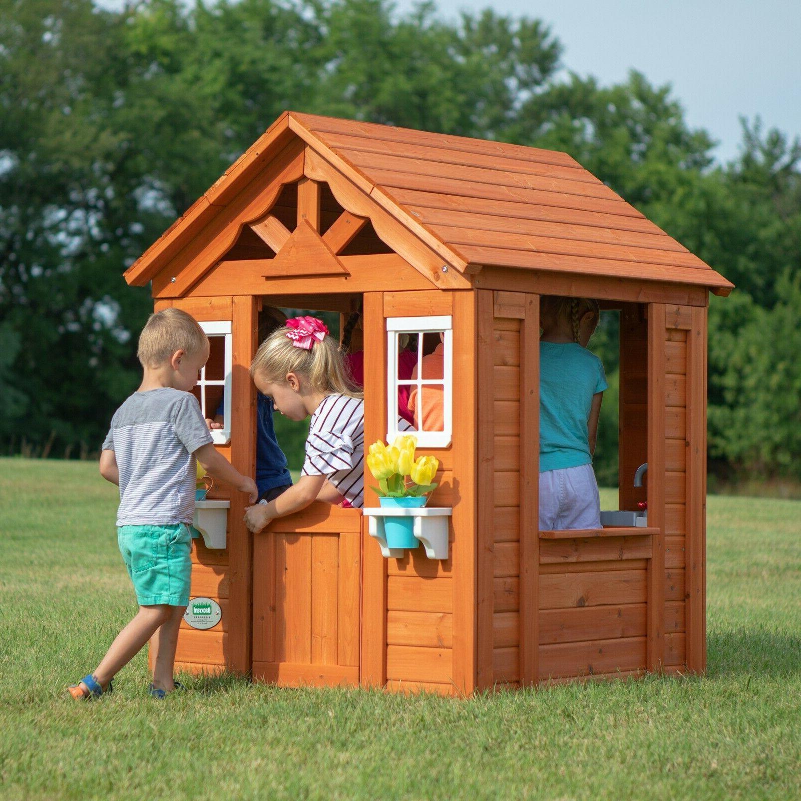backyard outdoor wooden kids playhouse wide windows