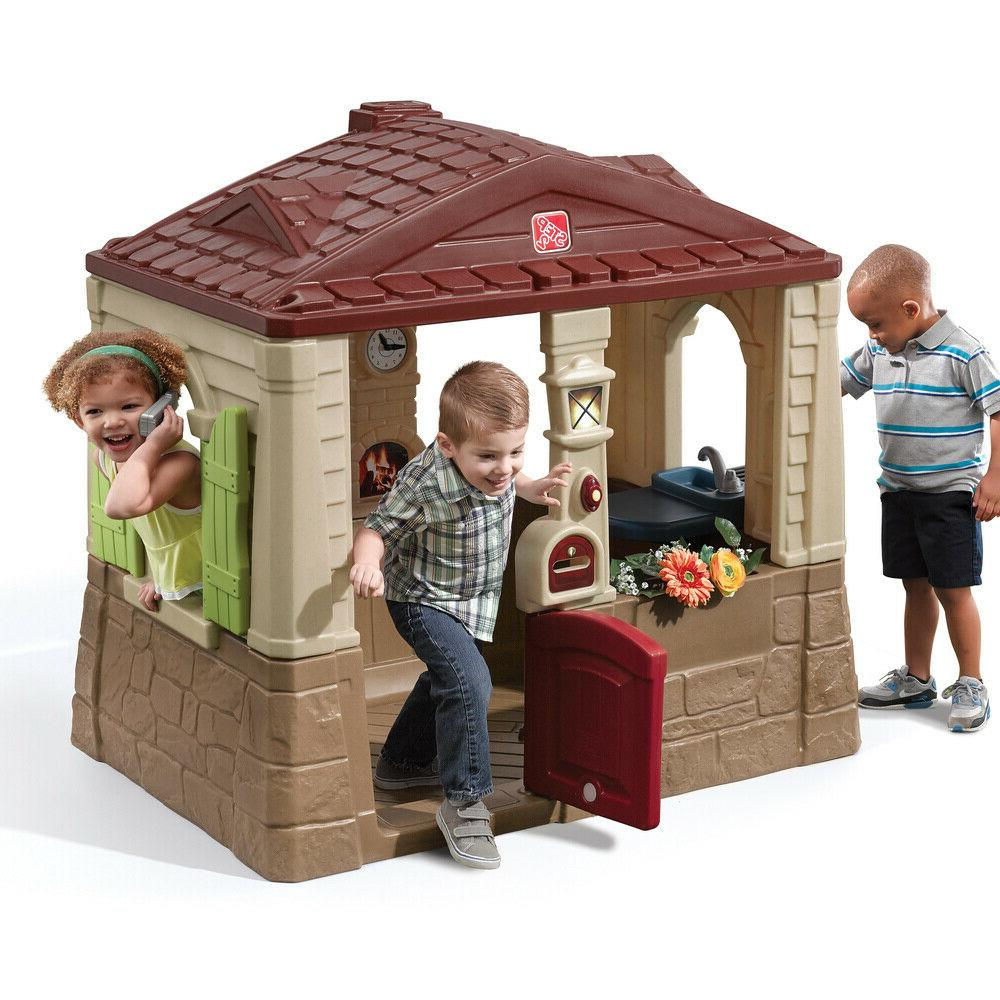 neat and tidy cottage ii brown playhouse