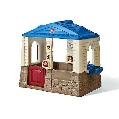 neat and tidy cottage blue playhouse