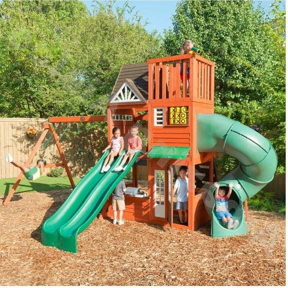 wooden playhouse with tunnel slide swings rock